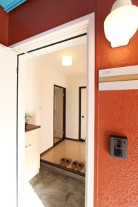 コスモクリアA103の玄関